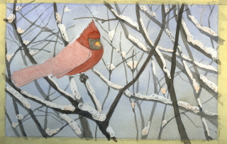cardinal in snowy bushes
